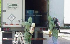 Hazmat workers checking a truck