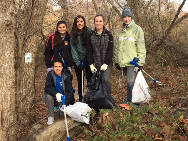 Colonial Forge students picking up trash in the woods