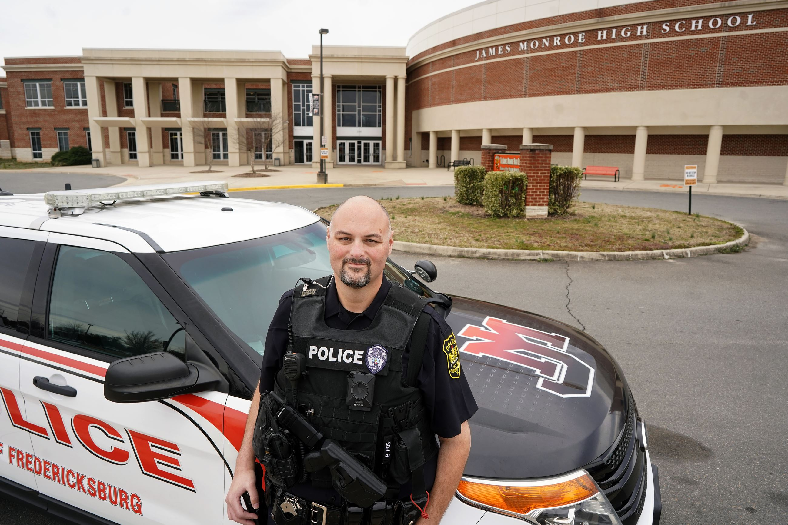 School resource officer outside of James Monroe High School